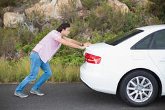 Man pushing car after a car breakdown Royalty Free Stock Photography