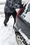Man pushing car stuck in snow Royalty Free Stock Photos