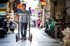 Man pushing cart Royalty Free Stock Photo
