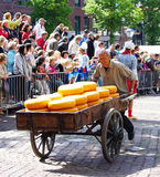Man pushing cheese on a cart Royalty Free Stock Photography