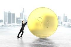 Man pushing dollar coin Stock Images