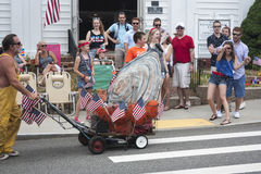 Man pushing giant oyster in the Wellfleet 4th of July Parade in Wellfleet, Massachusetts. Stock Images