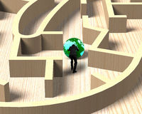 Man pushing globe in wooden maze game Royalty Free Stock Image