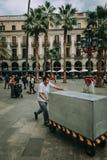 Man Pushing Gray Cart Stock Photo