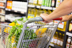Man pushing his trolley on aisle Royalty Free Stock Photo