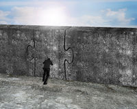 Man pushing huge puzzle door of concrete wall Royalty Free Stock Photography