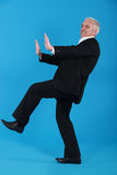 Man pushing invisible furniture Royalty Free Stock Photography