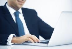 Man pushing keys of laptop Stock Photos