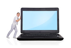 Man pushing laptop Royalty Free Stock Photo