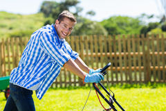 Man pushing lawnmower Royalty Free Stock Images
