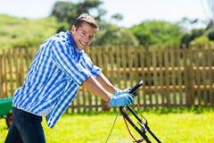 Man pushing lawnmower Royalty Free Stock Images