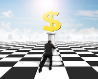 Man pushing money chess of golden dollar currency Royalty Free Stock Photos