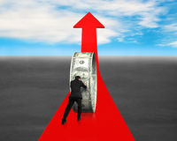 Man pushing money circle on red arrow Stock Photos