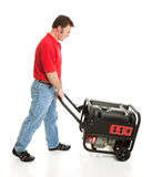 Man Pushing Portable Generator Royalty Free Stock Image