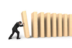 Man pushing and putting dominoes in line Stock Photo