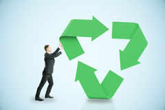 Man pushing recycling symbol. On blue background. 3D Rendering Stock Image
