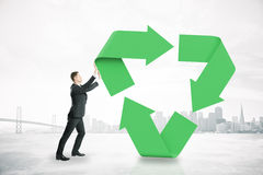 Man pushing recycling symbol Royalty Free Stock Images