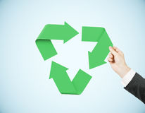 Man pushing recycling symbol. Man holding recycling symbol on blue background. 3D Rendering Royalty Free Stock Photos