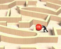 Man pushing red ball in wooden maze game Royalty Free Stock Image