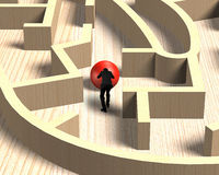 Man pushing red ball in wooden maze game Stock Photo