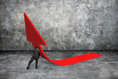 Man pushing red trend 3D arrow up. With gray concrete indoor background Royalty Free Stock Images