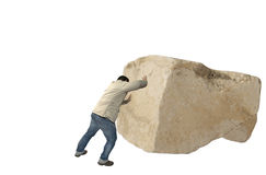 Man pushing a rock. Man casual dress pushing a big rock Royalty Free Stock Images
