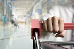 Man pushing shopping cart close-up front view Stock Images