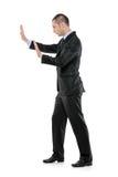 Man pushing something imaginary Royalty Free Stock Images