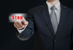 Man pushing the stop button Royalty Free Stock Image