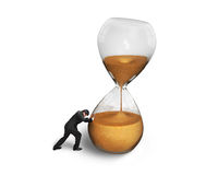 Man pushing tilt hourglass Royalty Free Stock Photo