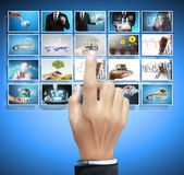 Man pushing on a touch screen digital photos Stock Image