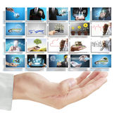 Man pushing on a touch screen digital photos Stock Photo