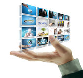 Man pushing on a touch screen digital photos Royalty Free Stock Photos