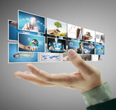 Man pushing on a touch screen digital photos Royalty Free Stock Photography