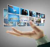 Man pushing on a touch screen digital photos Stock Photography