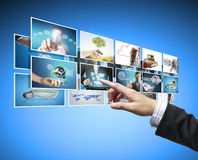 Man pushing on a touch screen digital photos Stock Images