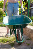 Man pushing wheelbarrow Stock Image