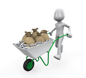 Man Pushing a Wheelbarrow Full of Money Royalty Free Stock Photos