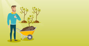 Man pushing wheelbarrow with plant. Stock Image