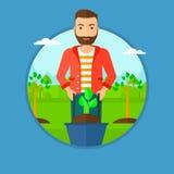Man pushing wheelbarrow with plant. Royalty Free Stock Image