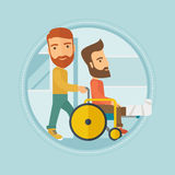 Man pushing wheelchair with patient. Stock Photos