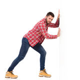 Man pushing a white wall Royalty Free Stock Photos