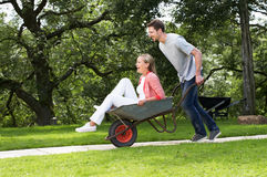 Man Pushing Woman In Wheelbarrow Royalty Free Stock Photo