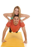 Man pushup woman on back smiles Royalty Free Stock Image