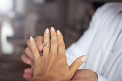 Man put engagement ring on finger of the girl. Stock Photos