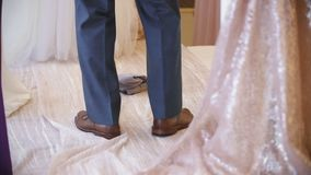 Man put on a foot on a small bag. One of the jewish wedding tradition-a groom put the foot on broken glass in bag stock footage