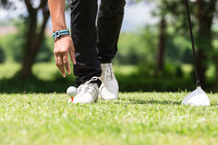 Man put golf ball. On teeing ground Royalty Free Stock Photography