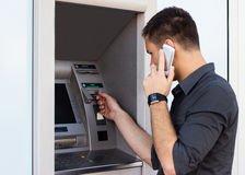 Man put his credit card at the atm Royalty Free Stock Photos