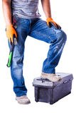 Man put his foot on the toolbox Stock Photos