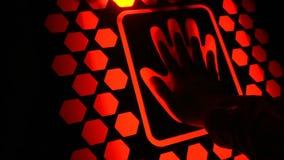 Man put his hand on the futuristic fingerprint scanning device biometric security